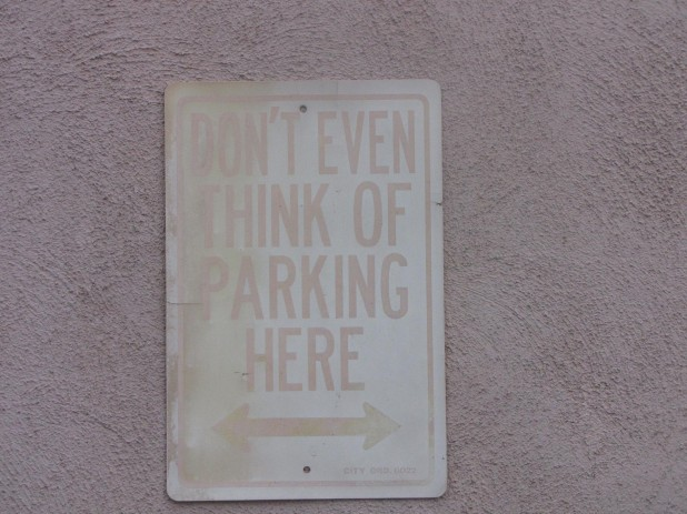 ('don't even think of parking here' sign)