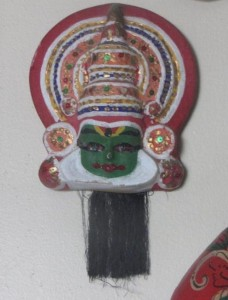 weird mask from India green face