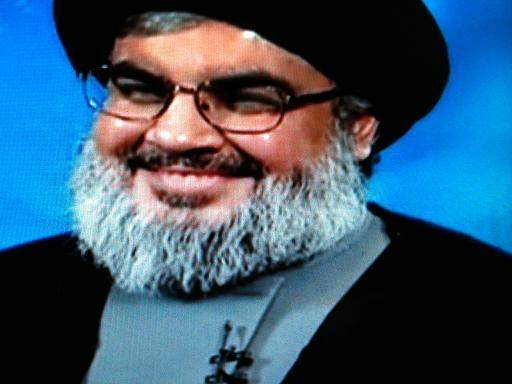 Assange Nasrallah Russia Today interview 011 smile