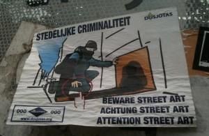 sticker 'beware street art' Amsterdam