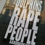 sticker 'dolphins rape people' Aardvark nyc