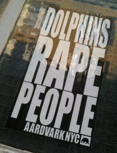 sticker 'dolphins rape people' Aardvark nyc