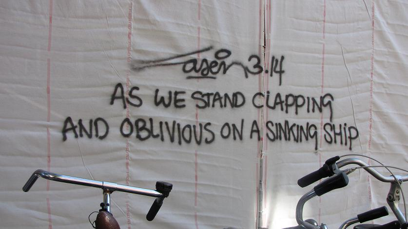 as we stand clapping and oblivious on a sinking ship graffiti Laser3.14