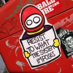 resist to what the system imposes sticker Amsterdam