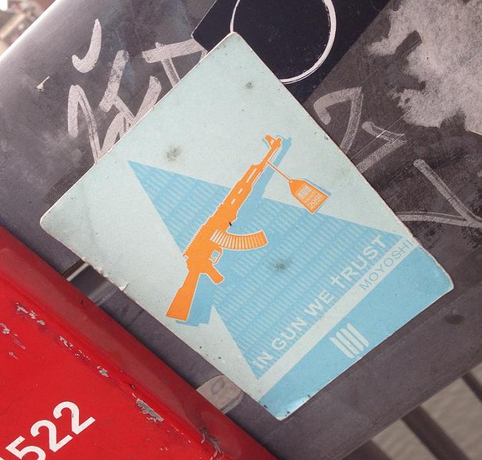 sticker in Gun we trust Moyoshi Amsterdam