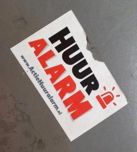 sticker Huuralarm actie Amsterdam 2013