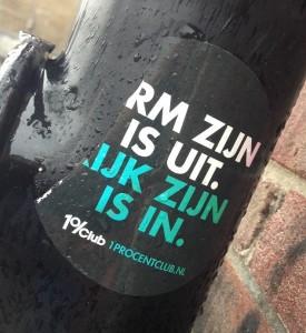 sticker 1 procent arm zijn uit rijk zijn in Amsterdam 2013