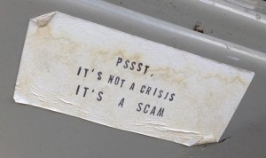 sticker pssst it's not a crisis it's a scam Amsterdam 2013 August