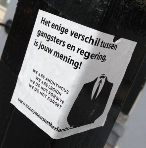 sticker het enige verschil tussen gangsters en de regering is jouw mening Amsterdam 2013 Anonymous