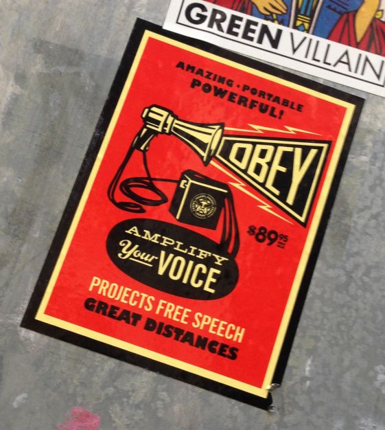 sticker obey free speech Amsterdam December 2013 amplify your voice