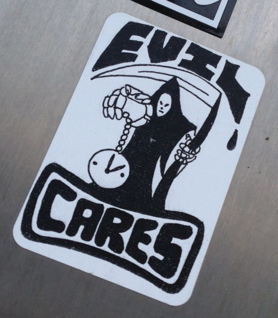 sticker evil cares Amsterdam center January 2014 clock death