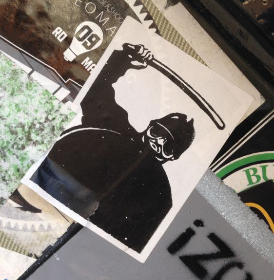 sticker police baton Amsterdam center October 2014 ski-mask