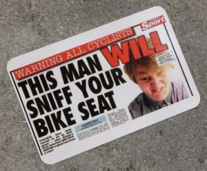 sticker warning cyclists this man will sniff bike seat Amsterdam center 2014 April