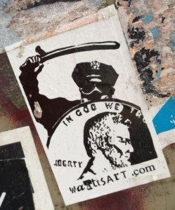 sticker watttsart Amsterdam center 2014 February police baton brutality god trust