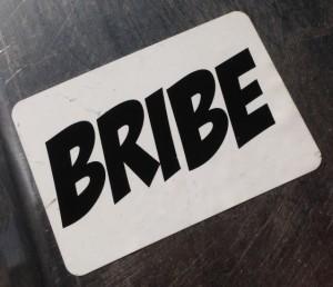 sticker Bribe Amsterdam center 2014 May corruption