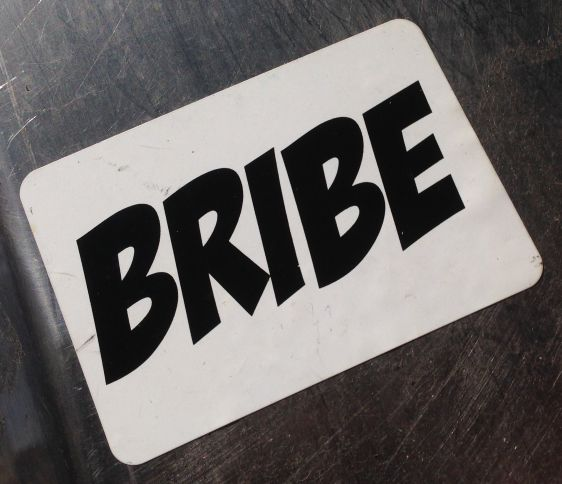 sticker Bribe Amsterdam center 2014 May corruption