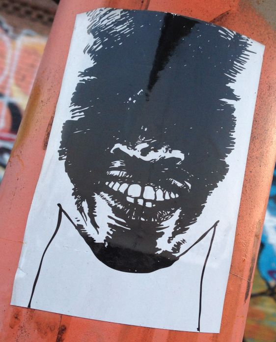 sticker dark face Amsterdam East 2014 March sinister crime
