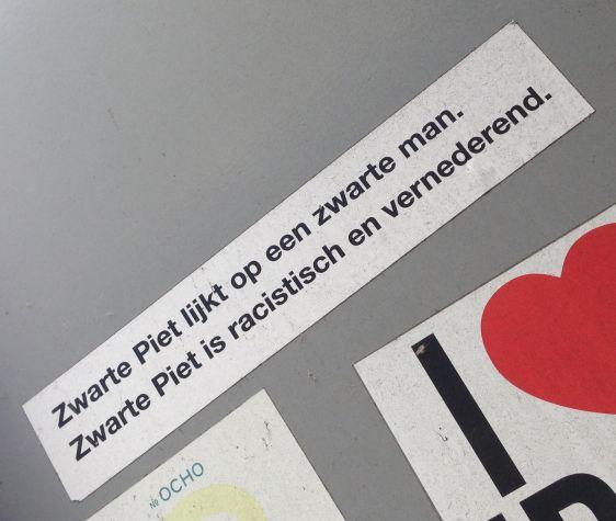 sticker zwarte piet racistisch vernederd Amsterdam ndsm 2014 May