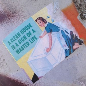 sticker clean house sign wasted life Amsterdam east 2014 April woman cleaning