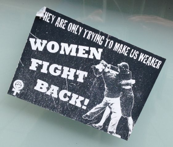 sticker Women fight back weaker Amsterdam East 2014 Juni feminism