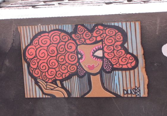 tegel 2014 July Dus Amsterdam Spuistraat street-art tile woman girl