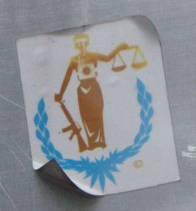 sticker Lady Justice Philadelphia 2014 July machine-gun weapon woman